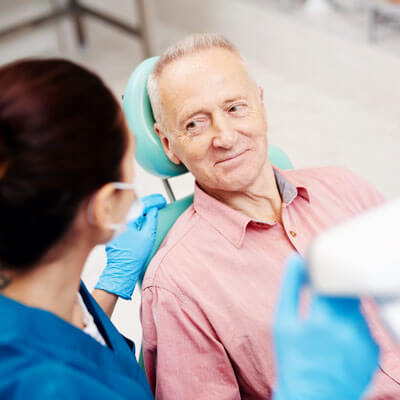 man-talking-with-dental-technician-sq-400